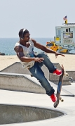 a young man launches from the ramp with his skateboard