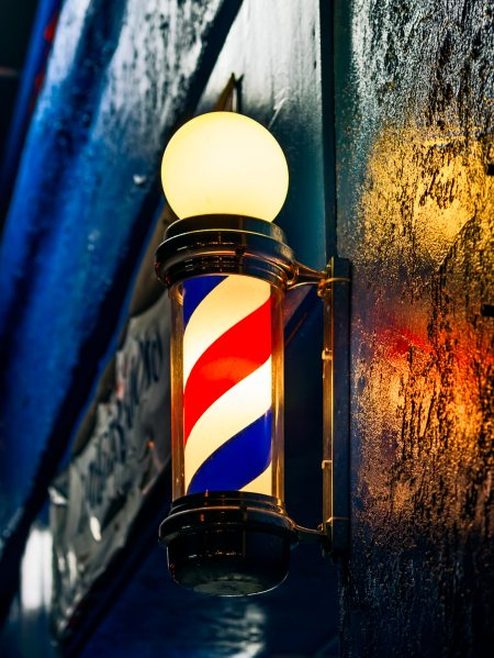 a barber's pole on a storefront